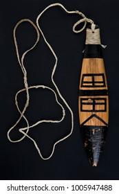 Replica of ancient artifact rainmaker bullroarer