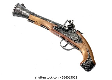 Replica of an antique flintlock, an old colonial era and pirate pistol similar to a musket but smaller to be used as a hand gun, isolated on white
