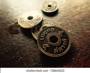 Replica coins, Bronze medal, Counterfeit coins for use in designated locations. Mulliga City in thailand, fucusing on 5 Satang coin