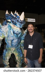 A replica of a Kaiju creature with builder Fon Davis at Stan Lee's Comikaze Expo in Los Angeles, California, October 2014.