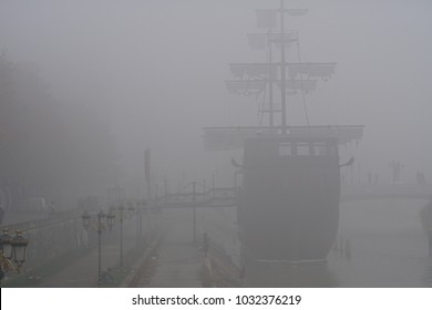 Replica of old caravel ship in the middle of fog