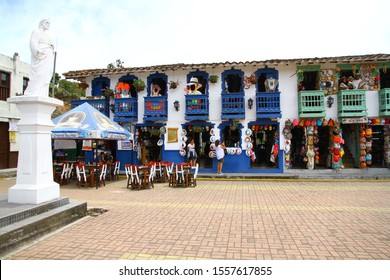 REPLICA OF OLD PENOL, MEDELLIN, COLOMBIA - 7 May 2019.A view from the square where they created a replica of Old Penol town which was flooded by the dam lake.There are touristic cafes and restaurants.