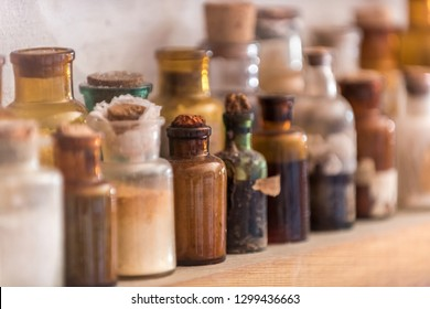Replica of an old pharmacy, we can see several bottles with chemicals, also dried medicinal herbs