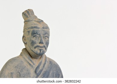 Replica of a terracotta infantryman from the funerary army of of a Chinese Emperor over white