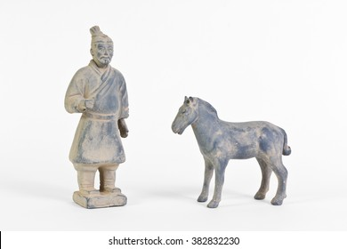 Replica of a terracotta infantryman and horse from the funerary army of a Chinese Emperor over white