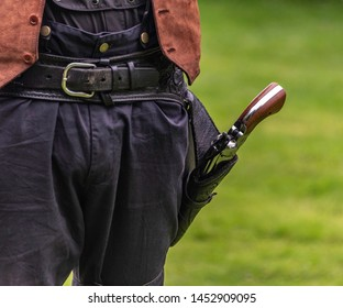 A replica wild west holster and pistol.