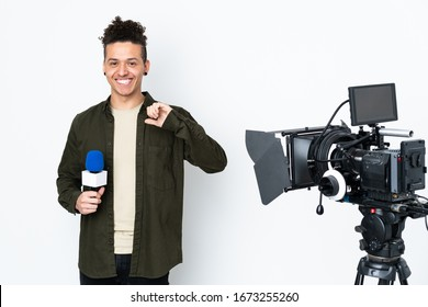 Reporter man holding a microphone and reporting news proud and self-satisfied