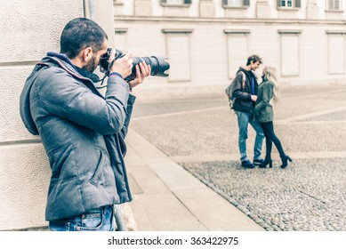 Reporter photographing a famous vip couple on a romantic date - Detective inquiring in a couple betrayal