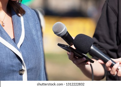 Reporters making media interview with business woman or female politician