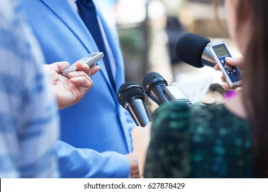 Reporters making media interview with business person or politician. Press conference. Journalism.