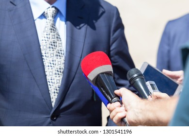 Reporters making media interview with businessman or politician at press conference