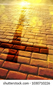 Representation of the way of salvation in the Christian religion with shadow of the cross on stone slabs and golden reflection of the sun. Vertical composition
