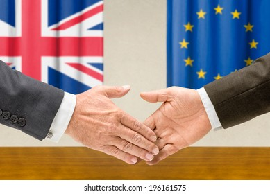 Representatives of the UK and the EU shake hands