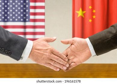 Representatives of the USA and China shake hands