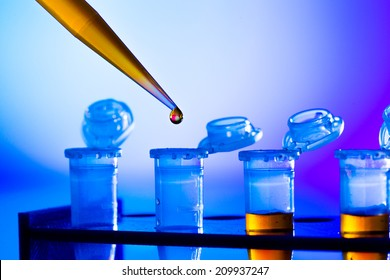 reprogenetics research in the laboratory, test tubes and pipette