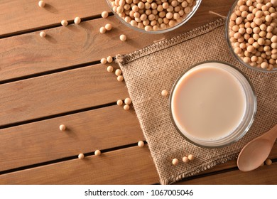 Reptientes with soy milk and grains on a wooden table. Alternative milk concept. Top view. Horizontal composition