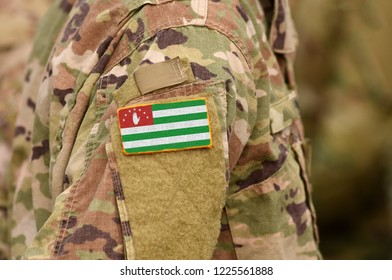 Republic of Abkhazia, flag on soldiers arm. Abkhazia troops (collage)