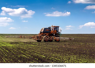 Republic of Bashkortostan, Ufa, RUSSIA - MAY 28, 2014: Agricultural machinery sprays the crop in spring in the sugar beet field