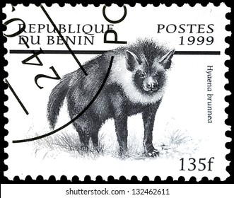 """REPUBLIC OF BENIN - CIRCA 1999: A stamp from Benin (formerly Dahomey) shows image of African animal Brown hyena (Hyaena brunnea), with the same inscription, from series """"Mammals"""", circa 1999"""