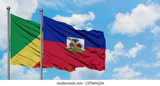 Republic Of The Congo and Haiti flag waving in the wind against white cloudy blue sky together. Diplomacy concept, international relations.