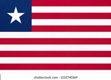 Republic Liberia national fabric flag textile background. Symbol of international world african country. State official Liberian sign.