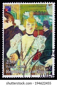 Republic of Niger - CIRCA 1998 A stamp printed in Republic of Niger shows a painting of La Goulue arriving at the Moulin Rouge by french painter Henri De Toulouse-Lautrec, circa 1998