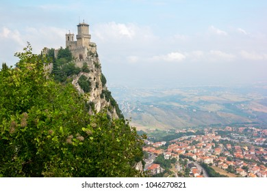 Republic of San Marino landscape: the ancient tower the Fortress of Guaita - first tower of the three towers on a peak of Monte Titano against a blue sky background
