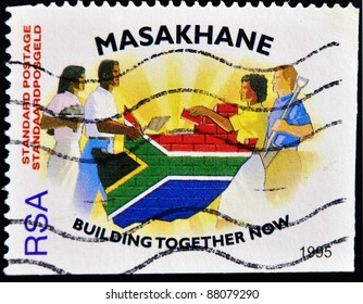 REPUBLIC OF SOUTH AFRICA - CIRCA 1995: A stamp printed in Republic of South Africa shows people of different races to build the country's flag, circa 1995