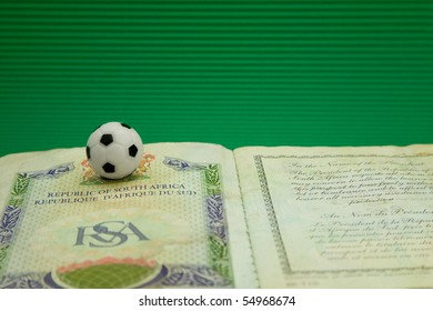 Republic of South Africa passport with a small football on top