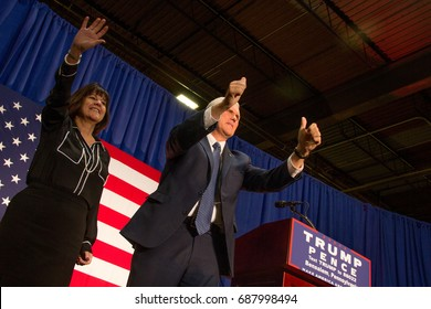 Republican vice presidential nominee Mike Pence, joined by his wife, gestures to the crowd after a campaign rally in Bensalem, PA, Friday, October 28, 2016.