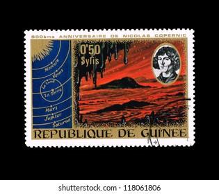 REPUBLIQUE DE GUINEE - CIRCA 1973 : A stamp printed in Republique de Guinee shows anniversaire de nicolas copernic, circa 1973