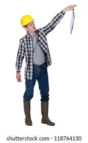 A repulsed tradesman dangling a clipboard