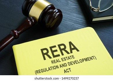 RERA or Real Estate Regulation and Development Act on the desk.
