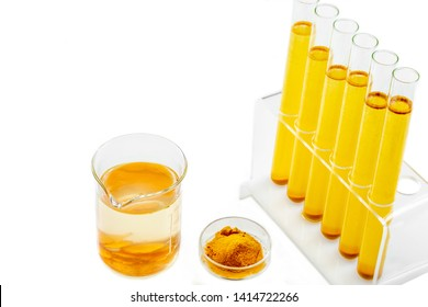 Resaerch on Curcuma. test tube with mater and curcuma with turmeric powder and turmeric root on white background