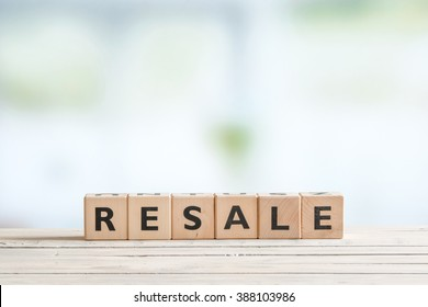Resale sign made of cubes on a wooden desk