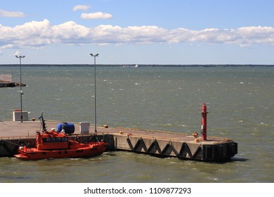 A rescue boat is docked and waiting to help other ships.