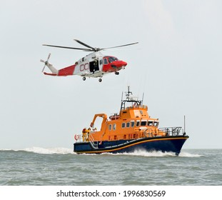 Rescue boat with Rescue Helicopter