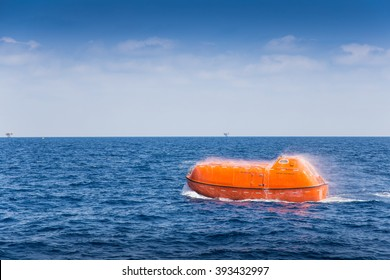 rescue boat or life boat at oil and gas platform annual sea trial test for preventive maintenance and testing to spry water for cool down when escaping or evacuate from fire when abandon platform