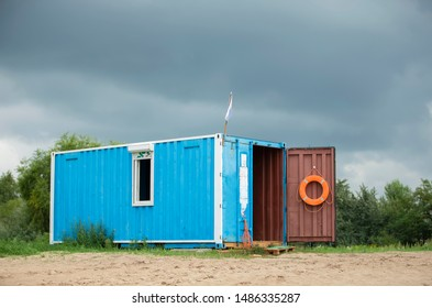 Rescue booth on the beach with an orange circle for rescue