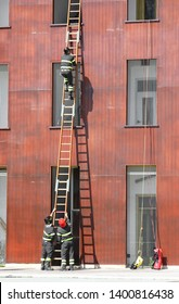 rescue exercises with the wooden and firefighters with helmet in firehouse