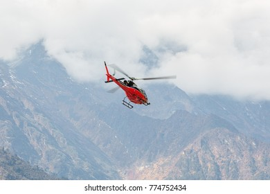 The rescue helicopter on the way from Namche Bazar to Tenzing-Hillary airport Lukla - Nepal, Himalayas