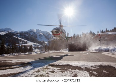 Rescue Helicopter is taking of in a Ski Resort in the Alps