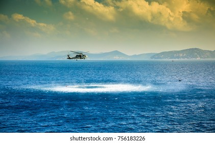 Rescue helicopter working in blue sea