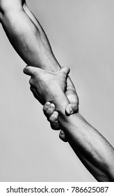 Rescue, helping gesture or hands. Strong hold. Two hands, helping hand of a friend. Handshake, arms, friendship. Friendly handshake, friends greeting, teamwork, friendship. Close-up. Black and white