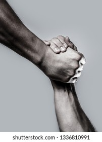Rescue, helping hand. Two hands, helping hand of a friend. Black and white. Man help hands, guardianship, protection. Handshake, arms. Friendly handshake, friends greeting.