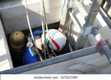 Rescue officials are going down to the concrete tank to rescue workers in confined spaces.