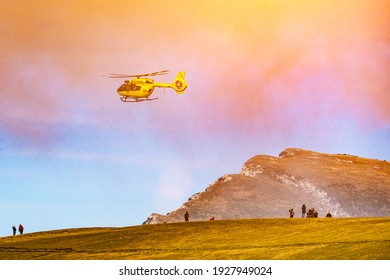 Rescue operation by helicopter to evacuate a wounded paraglider in the mountains Dolomites, Italy - 22 october 2019