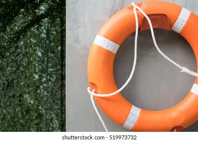 Rescue Swim Ring Hanging on Cement Wall