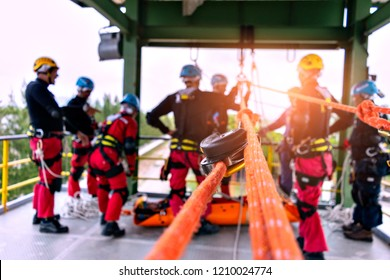 Rescue team in action practicing training for the use of ropes for rescue of high buildings . selective focus .  Concept for team ,teamwork and rescue.