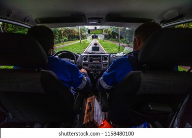 a rescue team is on a call, a view from the saloon of an emergency rescue vehicle, a driver and navigator in uniform, an interior of a rescue car, front seats and a car saloon, a person in trouble
